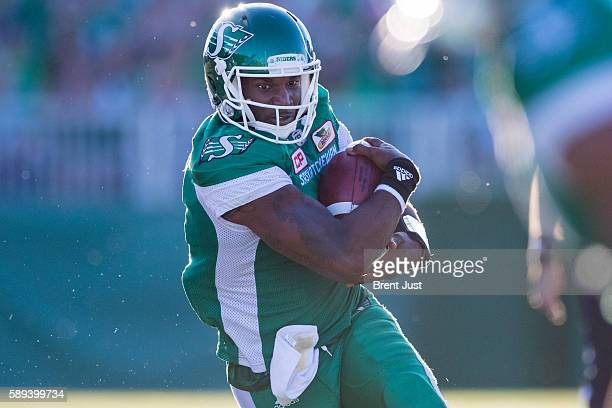 Darian Durant of the Saskatchewan Roughriders runs the ball in the game between the Calgary Stampeders and Saskatchewan Roughriders at Mosaic Stadium...