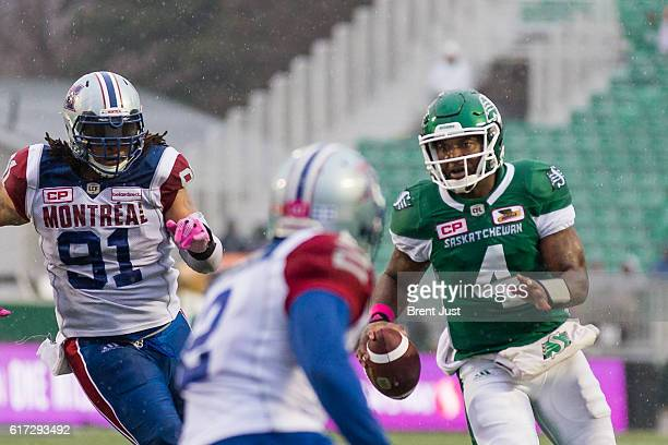 Darian Durant of the Saskatchewan Roughriders runs with the ball on his way to scoring a touchdown in the game between the Montreal Alouettes and...