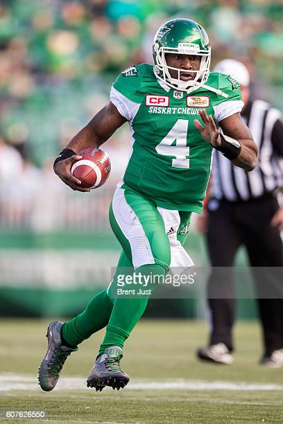 Darian Durant of the Saskatchewan Roughriders scrambles from the pocket in second half action of the game between the Edmonton Eskimos and...