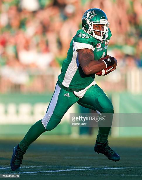 Darian Durant of the Saskatchewan Roughriders scrambles out of the pocket in the game between the Calgary Stampeders and Saskatchewan Roughriders at...