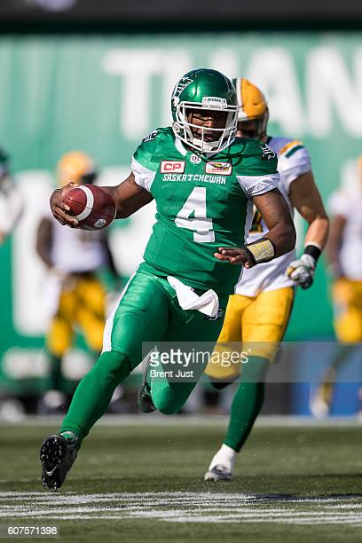 Darian Durant of the Saskatchewan Roughriders scrambles with the ball in first half action of the game between the Edmonton Eskimos and Saskatchewan...