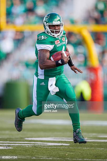 Darian Durant of the Saskatchewan Roughriders scrambles with the ball in the game between the Edmonton Eskimos and Saskatchewan Roughriders at Mosaic...