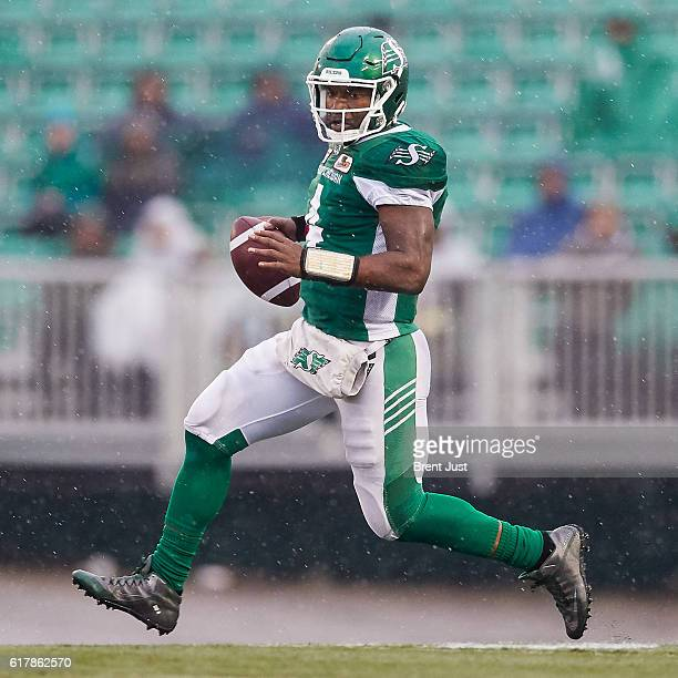 Darian Durant of the Saskatchewan Roughriders scrambles with the ball during the game between the Montreal Alouettes and Saskatchewan Roughriders at...