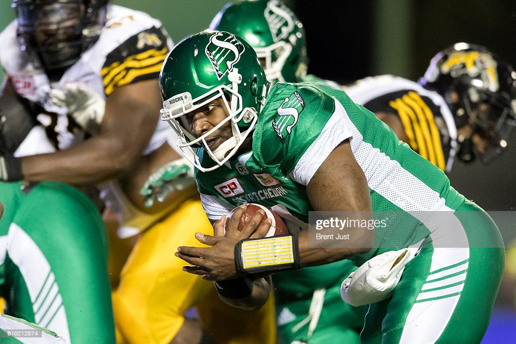 Darian Durant #4 of the Saskatchewan Roughriders sneaks the ball for a touchdown in the first half of the game between the Hamilton Tiger-Cats and Saskatchewan Roughriders at Mosaic Stadium on September 24, 2016 in Regina, Canada.