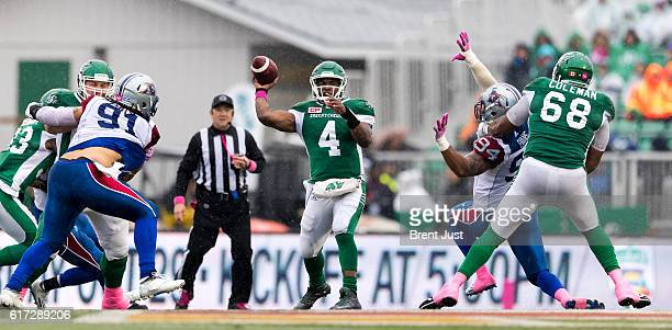 Darian Durant of the Saskatchewan Roughriders throws a pass from the pocket in first half action of the game between the Montreal Alouettes and...