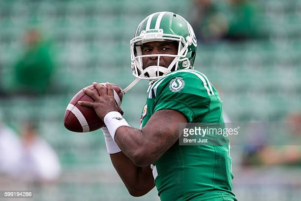 Darian Durant of the Saskatchewan Roughriders throws a pass in pregame warmup for the game between the Winnipeg Blue Bombers and Saskatchewan...