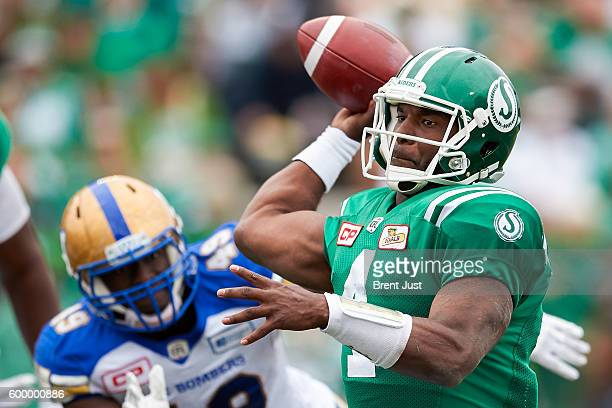 Darian Durant of the Saskatchewan Roughriders throws a pass in the game between the Winnipeg Blue Bombers and Saskatchewan Roughriders at Mosaic...