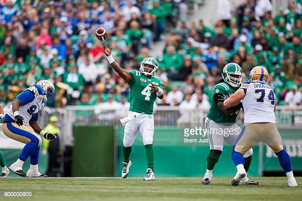 Darian Durant of the Saskatchewan Roughriders throws from the pocket during the game between the Winnipeg Blue Bombers and Saskatchewan Roughriders...
