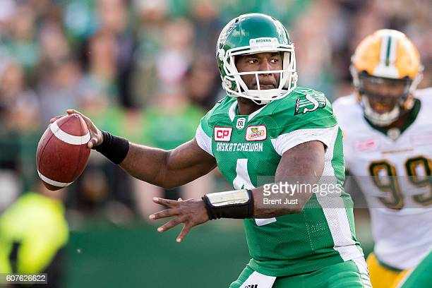Darian Durant of the Saskatchewan Roughriders winds up to throw a pass in the game between the Edmonton Eskimos and Saskatchewan Roughriders at...