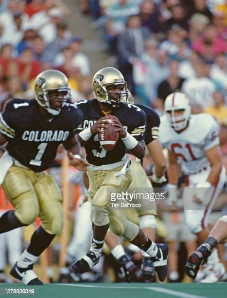 Darian Hagan, Quarterback for the University of Colorado Buffaloes prepares the football downfield during the NCAA Big -10 college football game...