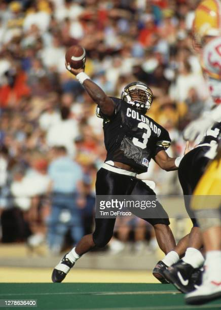 Darian Hagan, Quarterback for the University of Colorado Buffaloes throws the football downfield during the NCAA Big 8 college football game against...