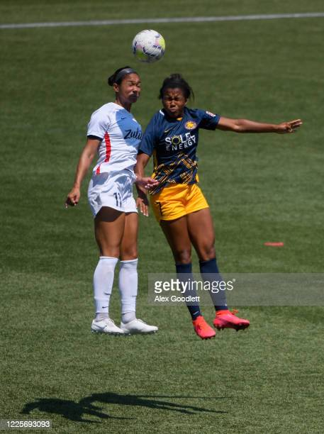 Darian Jenkins of OL Reign attempts a header with Elizabeth Ball of Utah Royals FC during a game on day 6 of the NWSL Challenge Cup at Zions Bank...