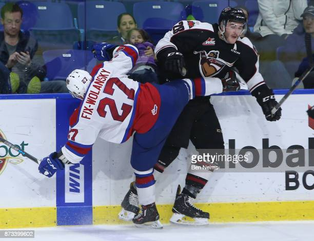 Darian Skeoch of the Vancouver Giants checks Trey FixWolanski of the Edmonton Oil Kings during the third period of their WHL game at the Langley...