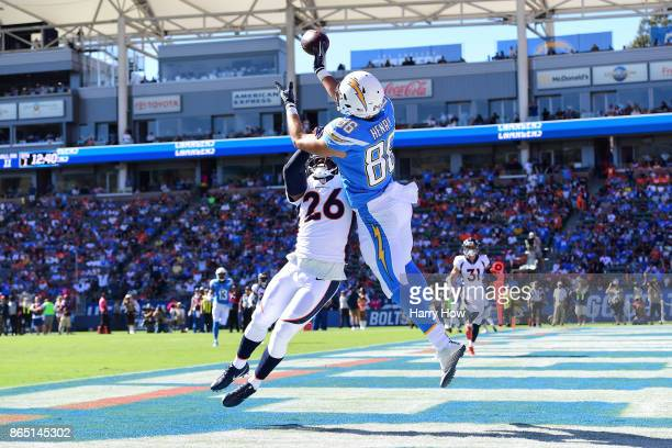 Darian Stewart of the Denver Broncos interferes with the pass from Hunter Henry of the Los Angeles Chargers during the first quarter at the StubHub...