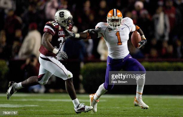 Darian Stewart of the South Carolina Gamecocks is stiff armed by James Davis of the Clemson Tigers during the first half at Williams-Brice Stadium on...