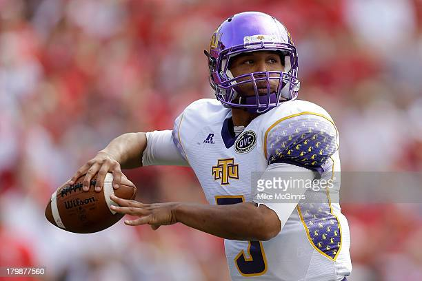 Darian Stone of the Tennessee Tech Golden Eagles drops back and passes the football during the first half of play against the Wisconsin Badgers at...