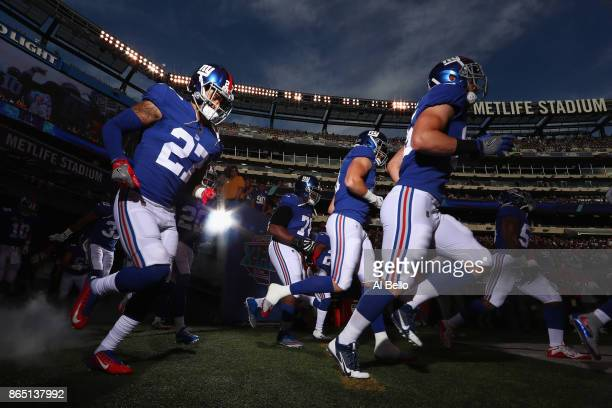 Darian Thompson of the New York Giants and teammates take the field before playing against the Seattle Seahawks at MetLife Stadium on October 22 2017...