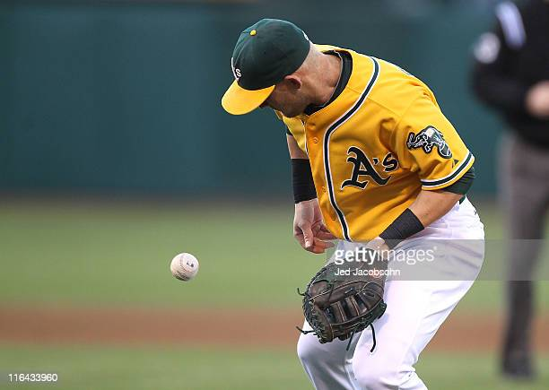Daric Barton of the Oakland Athletics fields a ball hit by Alex Gordon of the Kansas City Royals at the OaklandAlameda County Coliseum on June 15...