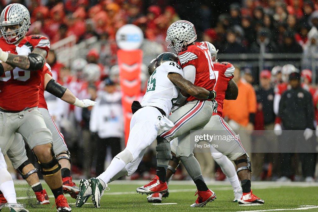 Darien Harris #45 of the Michigan State Spartans rushes J.T. Barrett #16 of the Ohio State Buckeyes at Ohio Stadium on November 21, 2015 in Columbus, Ohio.