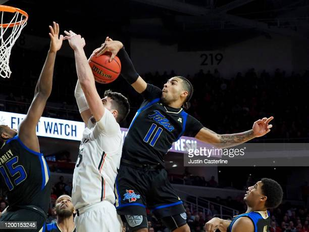 Darien Jackson of the Tulsa Golden Hurricane blocks the shot of Jaume Sorolla of the Cincinnati Bearcats at Fifth Third Arena on January 08, 2020 in...