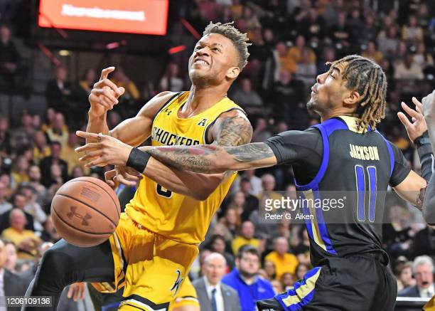 Darien Jackson of the Tulsa Golden Hurricane slaps the ball away from Dexter Dennis of the Wichita State Shockers during the first half at Charles...