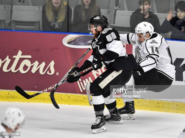 Darien Kielb of the Gatineau Olympiques falls as he skates after Pascal Corbeil of the BlainvilleBoisbriand Armada during the QMJHL game at Centre...