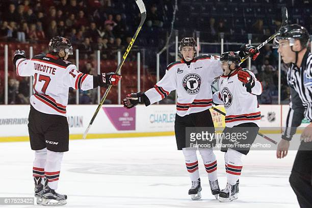 Darien Kielb of the Quebec Remparts celebrates his first league goal with teammates Yanick Turcotte and Christian Huntley in a game against the...