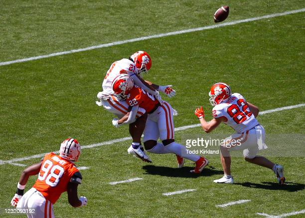 Darien Rencher of the Clemson Tigers is hit hard by Trenton Simpson during the second half of the Clemson Orange and White Spring Game at Memorial...