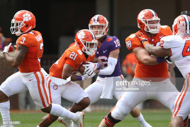 Darien Rencher takes a handoff from Trevor Lawrence during action in the Clemson Spring Football game at Clemson Memorial Stadium on April 14 2018 in...