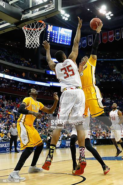 Darien Walker of the Valparaiso Crusaders takes a shot over Damonte Dodd of the Maryland Terrapins during the second round of the Men's NCAA...