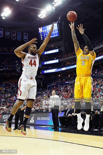 Darien Walker of the Valparaiso Crusaders takes a shot over Dez Wells of the Maryland Terrapins during the second round of the Men's NCAA Basketball...