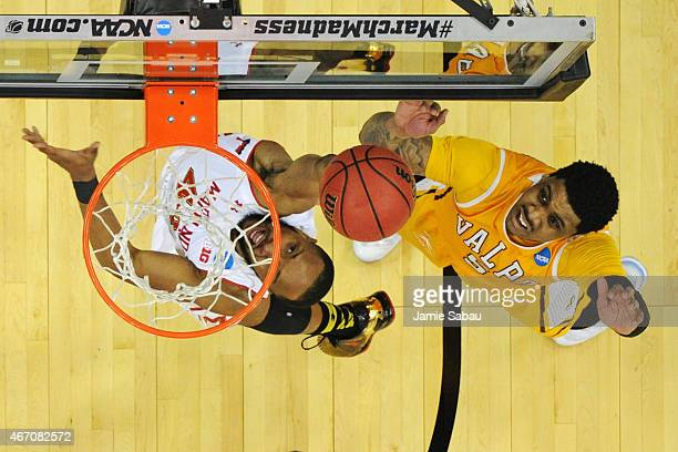 Darien Walker of the Valparaiso Crusaders watches as Dez Wells of the Maryland Terrapins makes a layup during the second round of the 2015 NCAA Men's...