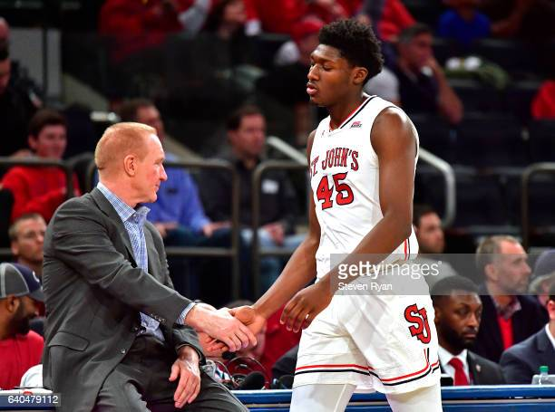 Darien Williams shakes hands with his head coach Chris Mullin of the St John's Red Storm as he leaves the game against the Xavier Musketeers at...