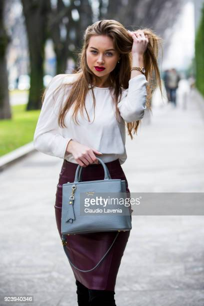 Dariia wearing a purple skirt and white shirt is seen outside Giorgio Armani show during Milan Fashion Week Fall/Winter 2018/19 on February 24 2018...