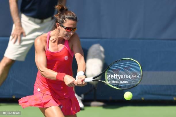 Darija Jurak of Croatia returns a backhand shot during the Women's Doubles semifinal against Belinda Bencic of Switzerland and Anhelina Kalinina of...