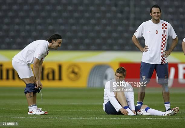 Darijo Srna drops his shorts in front of Ivan Klasnic and Josip Simunic of Croatia during the Croatian National Football Team training session at the...