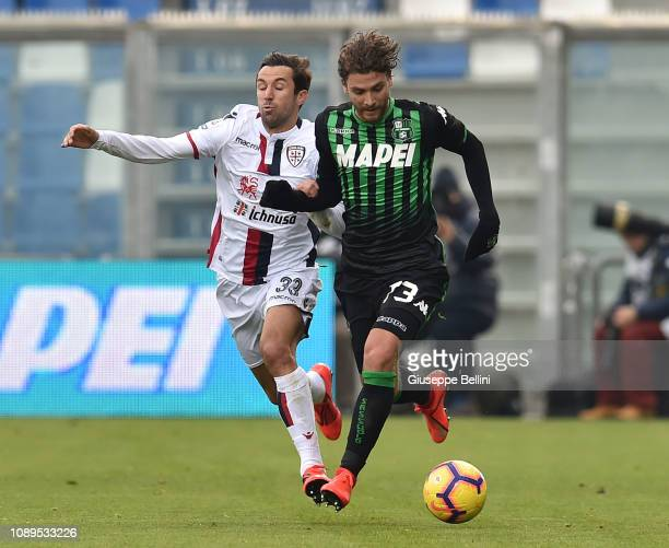 Darijo Srna of Cagliari and Manuel Locatelli of US Sassuolo in action during the Serie A match between US Sassuolo and Cagliari at Mapei Stadium...