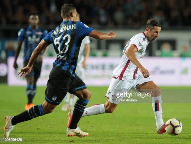 Darijo Srna of Cagliari Calcio is challenged by Ali Adnan of Atalanta BC during the serie A match between Atalanta BC and Cagliari at Stadio Atleti...