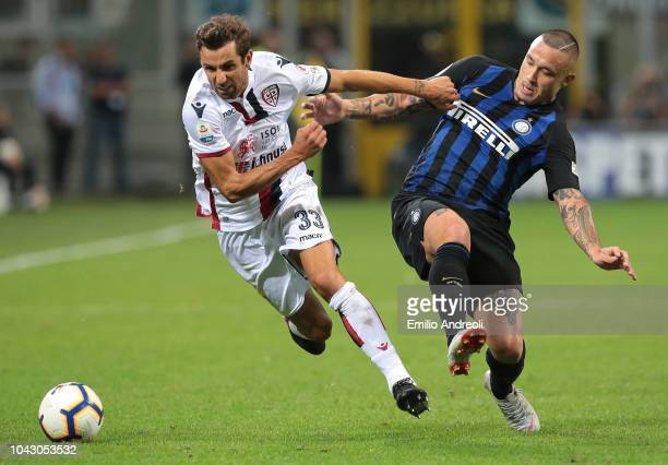 Darijo Srna of Cagliari Calcio is challenged by Radja Nainggolan of FC Internazionale during the Serie A match between FC Internazionale and Cagliari...