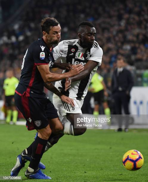 Darijo Srna of Cagliari competes for the ball with Blaise Matuidi of Juventus during the Serie A match between Juventus and Cagliari on November 3...