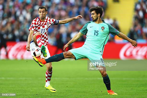 Darijo Srna of Croatia and Andre Gomes of Portugal compete for the ball during the UEFA EURO 2016 round of 16 match between Croatia and Portugal at...