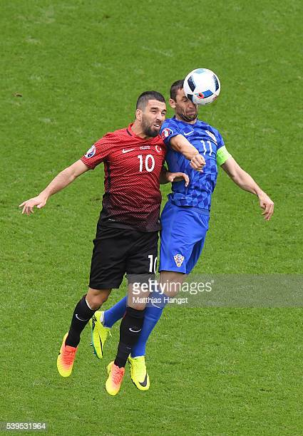 Darijo Srna of Croatia and Arda Turan of Turkey compete for the ball during the UEFA EURO 2016 Group D match between Turkey and Croatia at Parc des...
