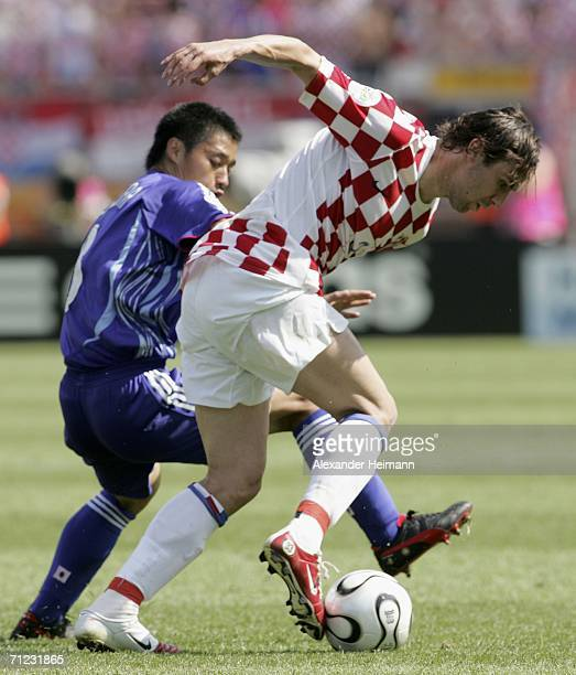 Darijo Srna of Croatia is tackled by Mitsuo Ogasawara of Japan during the FIFA World Cup Germany 2006 Group F match between Japan and Croatia at the...