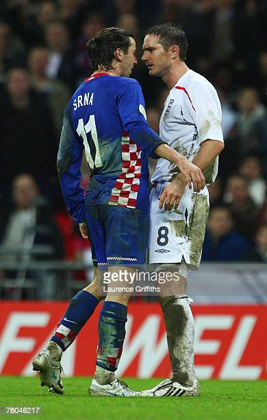 Darijo Srna of Croatia squares Frank Lampard of England during the Euro 2008 Group E qualifying match between England and Croatia at Wembley Stadium...