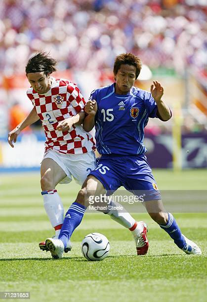 Darijo Srna of Croatia tangles with Takashi Fukunishi of Japan during the FIFA World Cup Germany 2006 Group F match between Japan and Croatia at the...