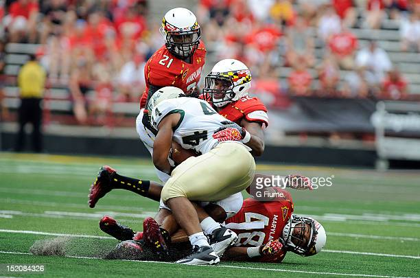 Darin Drakeford of the Maryland Terrapins makes a tackle against Meltoya Jones of the William Mary Tribe at Byrd Stadium on September 1 2012 in...
