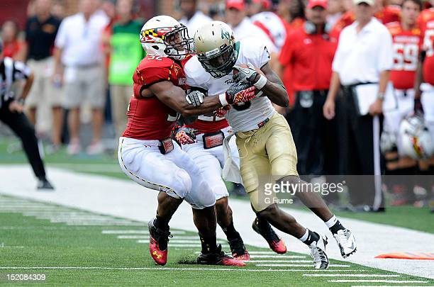 Darin Drakeford of the Maryland Terrapins makes a tackle against Tre McBride of the William Mary Tribe at Byrd Stadium on September 1 2012 in College...