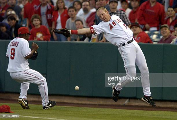 Darin Erstad and Chone Figgins of the Los Angeles Angels of Anaheim are unable to catch a fly ball during 65 victory in 10 innings over the Cleveland...