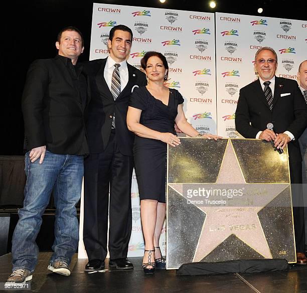 Darin Feinstein poses for photos with Gloria Estefan and Emilio Estefan at the Crown Nightclub at the Rio Hotel Casino on April 29 2010 in Las Vegas...