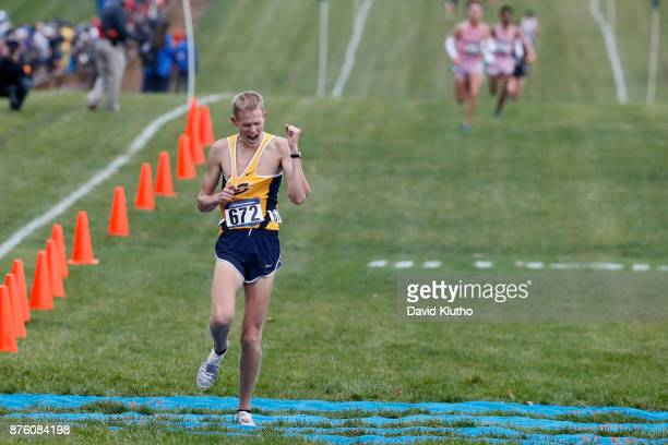 Darin Lau from the University of Wisconsin EauClaire win the national championship during the Division III Men's and Women's NCAA Cross Country...